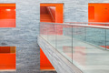 Catwalk modern building with several floors and orange painted passages - PhotoDune Item for Sale