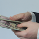 Businessman Counts Fifty Dollar Bills - VideoHive Item for Sale