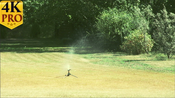 A Grass Sprinkler Putting Some Water