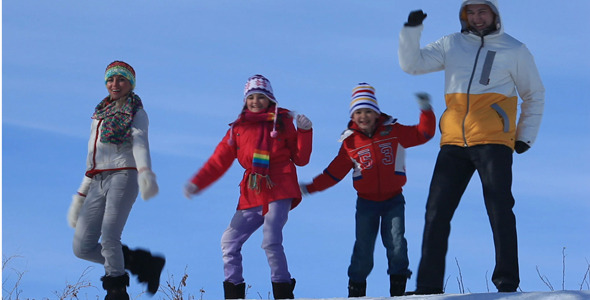 Family Dancing On Snow