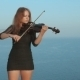 Young Violinist Plays With Inspiration By The Sea - VideoHive Item for Sale