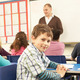 Schoolchildren Studying In Classroom With Teacher - PhotoDune Item for Sale