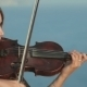 Young Violinist In Tracery Dress Plays On a Rock - VideoHive Item for Sale