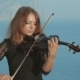 Beautiful Violinist In Tracery Dress Plays On a - VideoHive Item for Sale