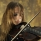 Lovely Girl In Black Dress Playing The Violin On a - VideoHive Item for Sale