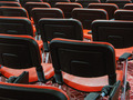 rows of red chairs in empty conference hall - PhotoDune Item for Sale
