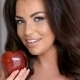 Smiling Pretty Woman Holding Fresh Red Apple - VideoHive Item for Sale