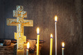 Orthodox Christian still life with old metal cross and burning candles - PhotoDune Item for Sale