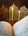 Orthodox Christian still life with open ancient book and burning candles - PhotoDune Item for Sale