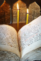Orthodox Christian still life with open book and burning candles (focus on foreground) - PhotoDune Item for Sale
