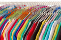 Colored shirts on hangers steel closeup. - PhotoDune Item for Sale