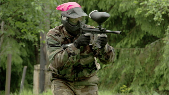 A Man Walking with the Shooting Paintball