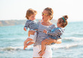 Mother with children on the beach - PhotoDune Item for Sale