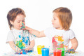 Little boy and girl playing with paints - PhotoDune Item for Sale