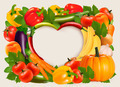 Heart shaped background made of vegetables and fruit.