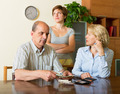 Adult daughter and parents with money - PhotoDune Item for Sale