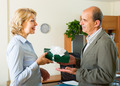 Female secretary congratulates boss in office - PhotoDune Item for Sale