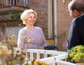 Mature couple talking on terrace - PhotoDune Item for Sale