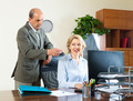 office scene with two aged co-workers - PhotoDune Item for Sale