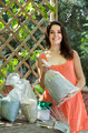 Woman with fertilizer granules in bag - PhotoDune Item for Sale