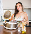 Housewife cooking with multi cooker - PhotoDune Item for Sale