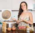 Woman cooking with electric multicooker - PhotoDune Item for Sale