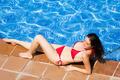 Girl in bikini resting near pool - PhotoDune Item for Sale