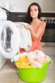 Tired woman near washing machine - PhotoDune Item for Sale