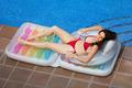 Beautiful girl resting in air mattress - PhotoDune Item for Sale