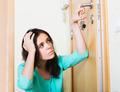 Woman trying to lock door - PhotoDune Item for Sale