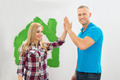 Couple Giving High Five To Each Other - PhotoDune Item for Sale