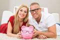 Happy Couple With Piggybank - PhotoDune Item for Sale