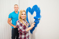 Couple Painting Heart On Wall - PhotoDune Item for Sale
