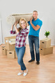 Couple Carrying Rolled Carpet - PhotoDune Item for Sale