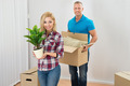 Young Couple Moving Boxes In New Home - PhotoDune Item for Sale