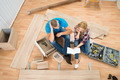 Thoughtful Couple With Disassembled Furniture - PhotoDune Item for Sale