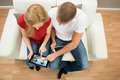 Couple On Sofa Watching Video On Digital Tablet - PhotoDune Item for Sale
