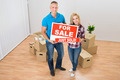 Couple Holding Sold Sign - PhotoDune Item for Sale