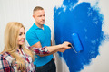 Young Couple Painting Wall - PhotoDune Item for Sale