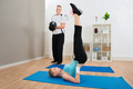 Young Couple Exercising At Home - PhotoDune Item for Sale