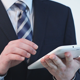 Man in a Suit Uses a Tablet - VideoHive Item for Sale