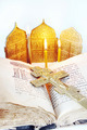 Orthodox Christian still life with an open ancient Bible and metal cross on light background - PhotoDune Item for Sale