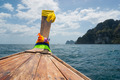 Traditional Thai Longtail boat and island of Phi Phi Leh on the - PhotoDune Item for Sale