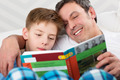 Son and father reading book together - PhotoDune Item for Sale