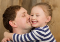 Happy father kissing little daughter - PhotoDune Item for Sale