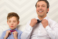 Father and son adjusting bowties - PhotoDune Item for Sale