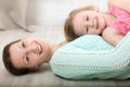 Smiling mother and daughter on the floor - PhotoDune Item for Sale