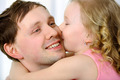Little girl kissing fathers cheek - PhotoDune Item for Sale