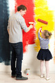 Father and daughter painting wall - PhotoDune Item for Sale