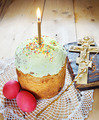 Classical Orthodox Christian Easter still life with red eggs and burning candle over the cake - PhotoDune Item for Sale